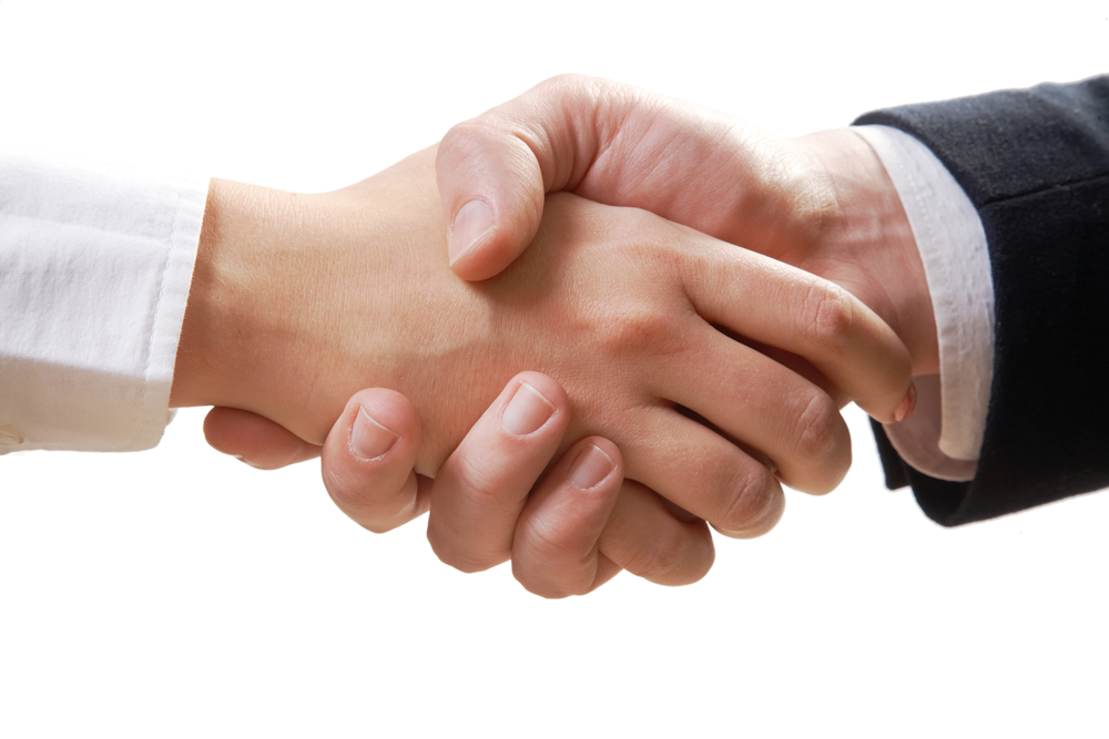 man and woman shaking hands during divorce