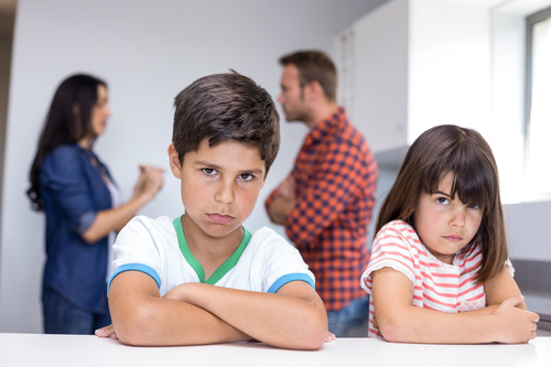 Parents arguing in front of children in the kitchen