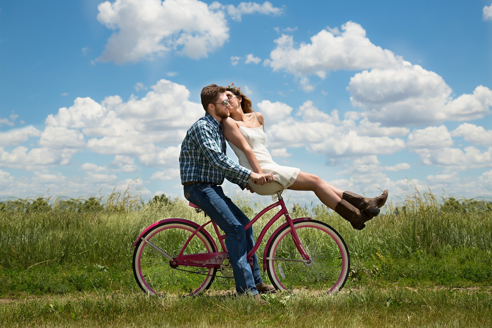 Couple in love riding a bike