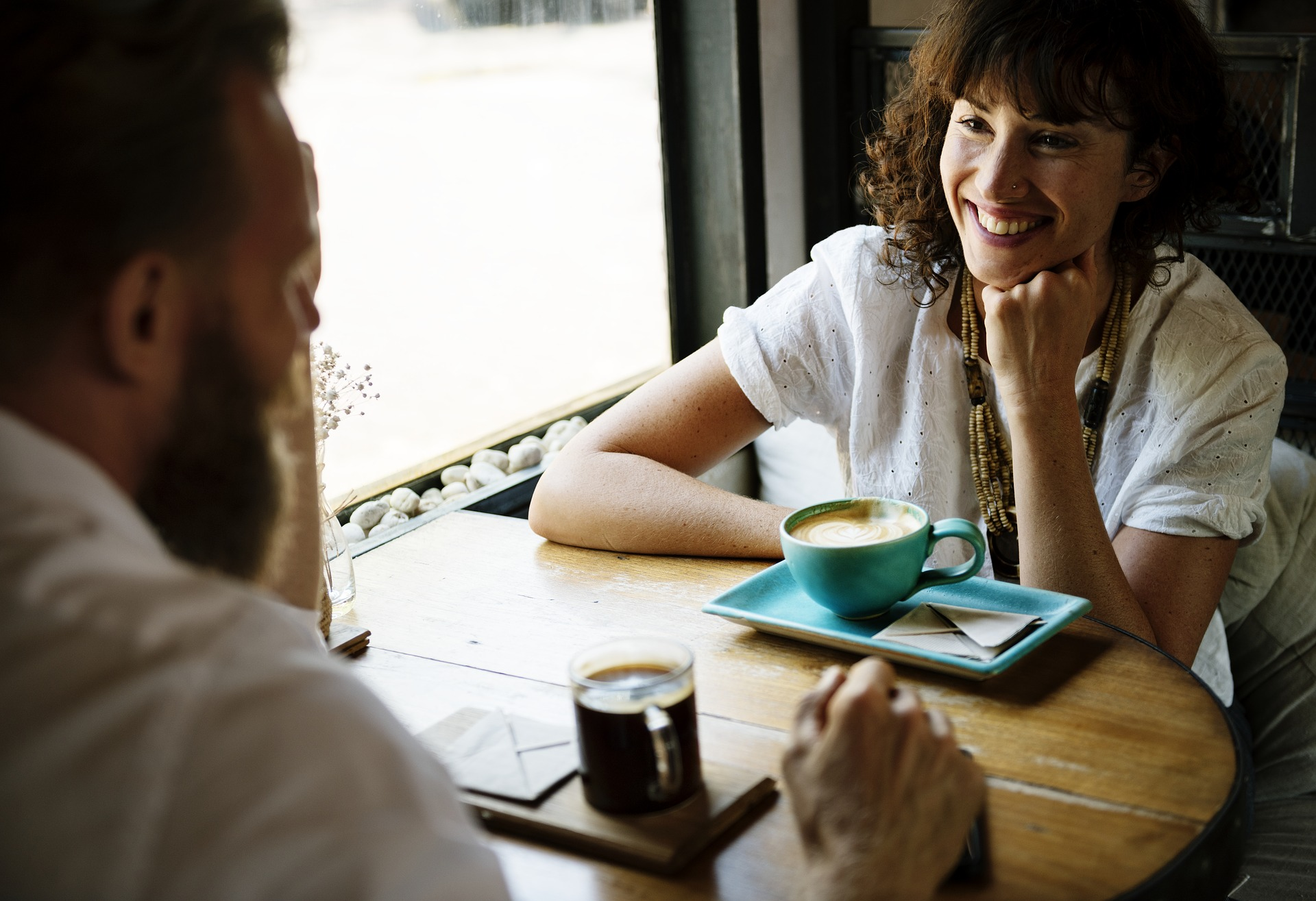 Man and woman talking over a cup of coffee