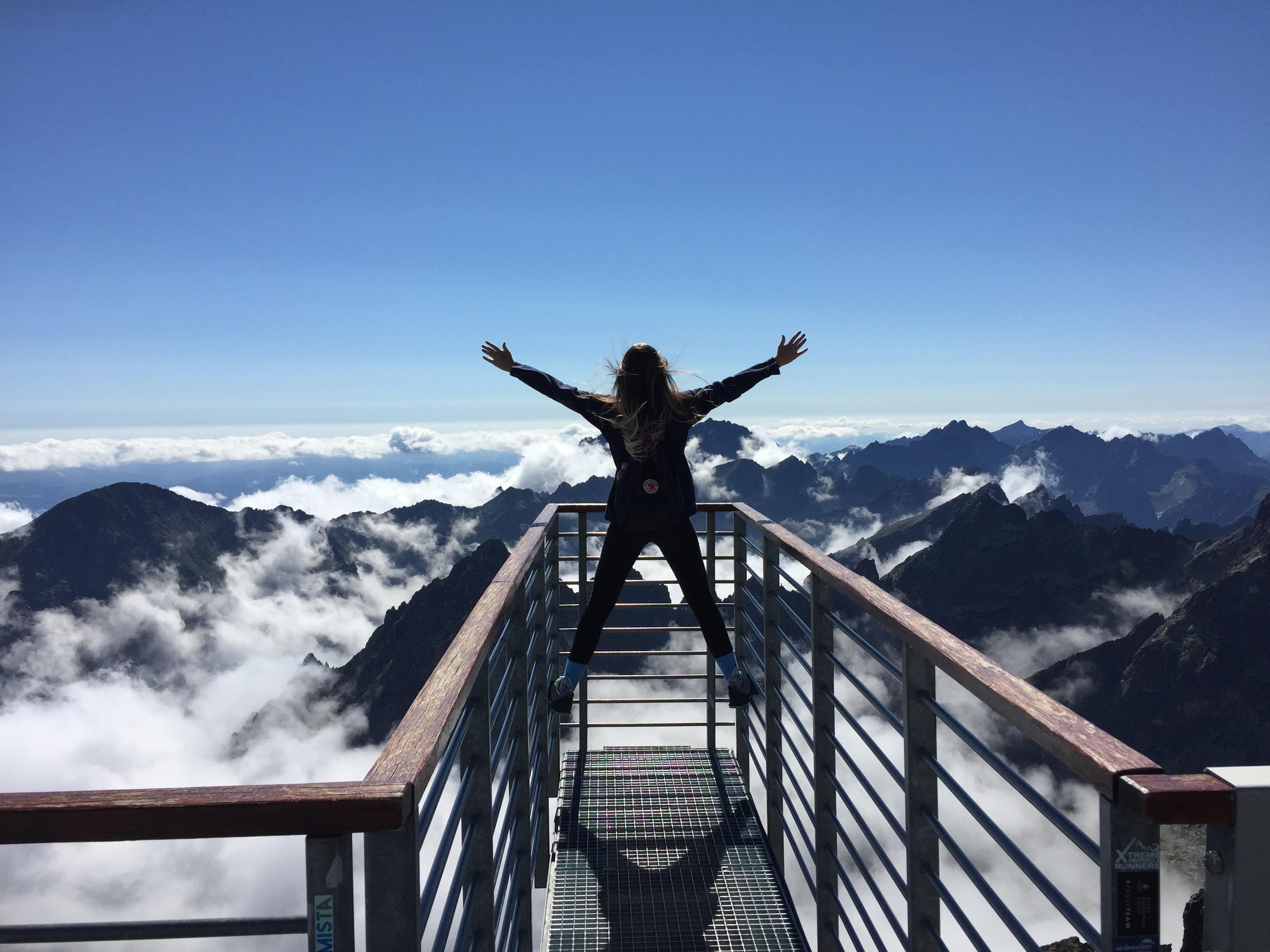 Happy woman overlooking a snowy mountain range