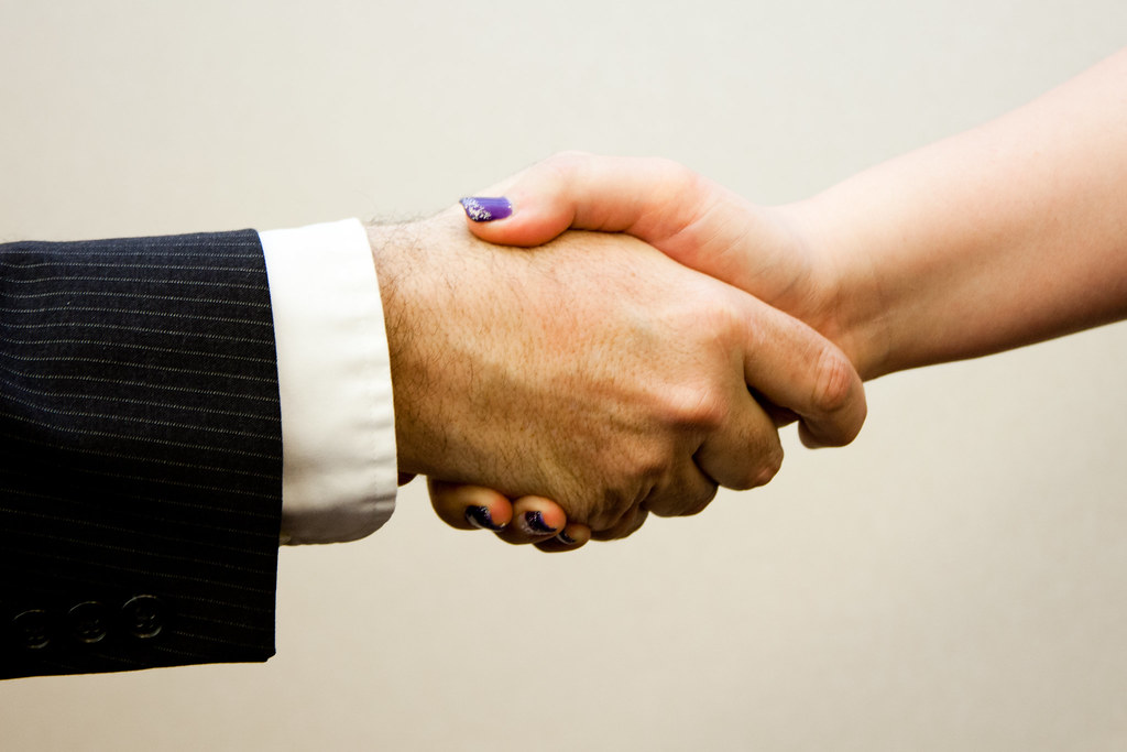 Couple shaking hands during Collaborative Divorce