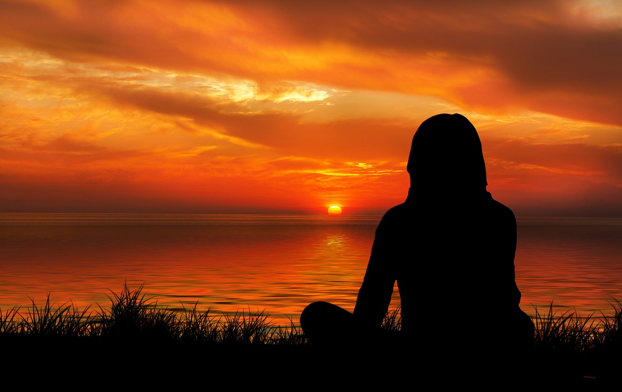 Meditation Silhouette of Woman during evening sunset