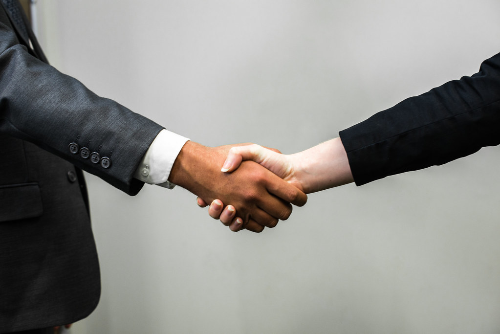Man and woman shaking hands after divorce