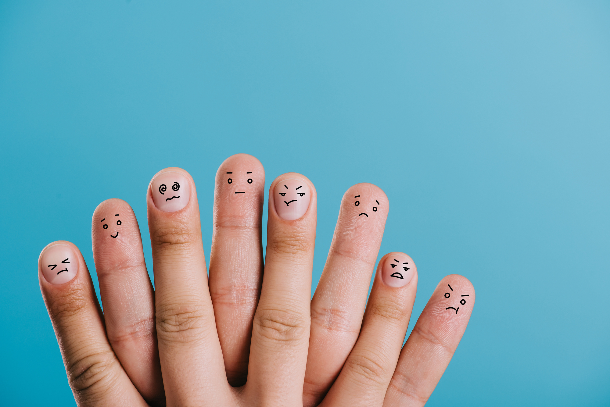 Human fingers showing different emotions felt during divorce