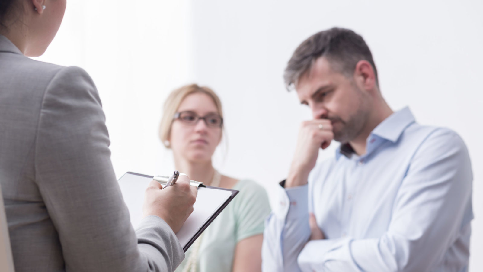 Shot of a mediator taking notes during the divorce mediation