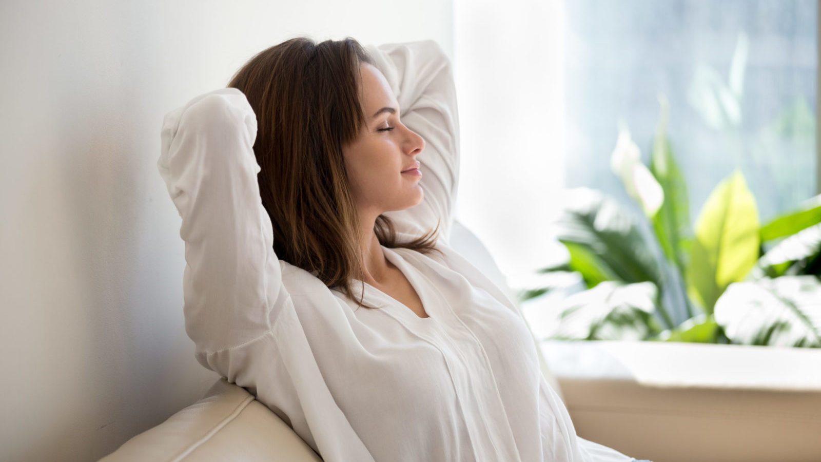 Relaxed woman resting breathing fresh air and practicing mindfulness