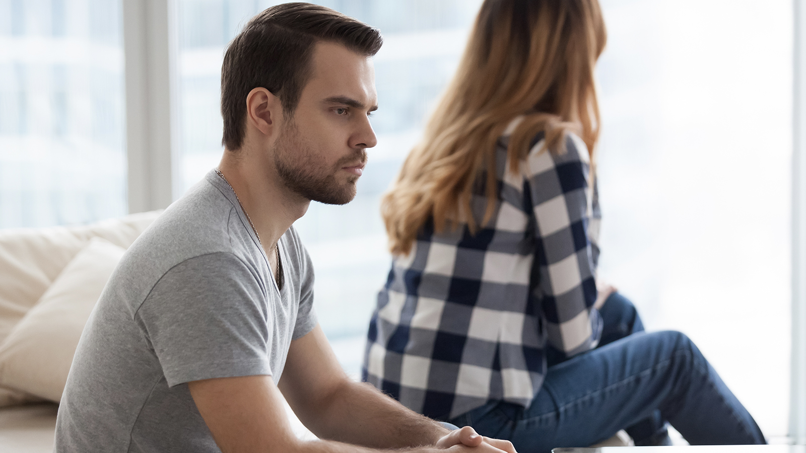 Thoughtful husband ignore wife during a divorce