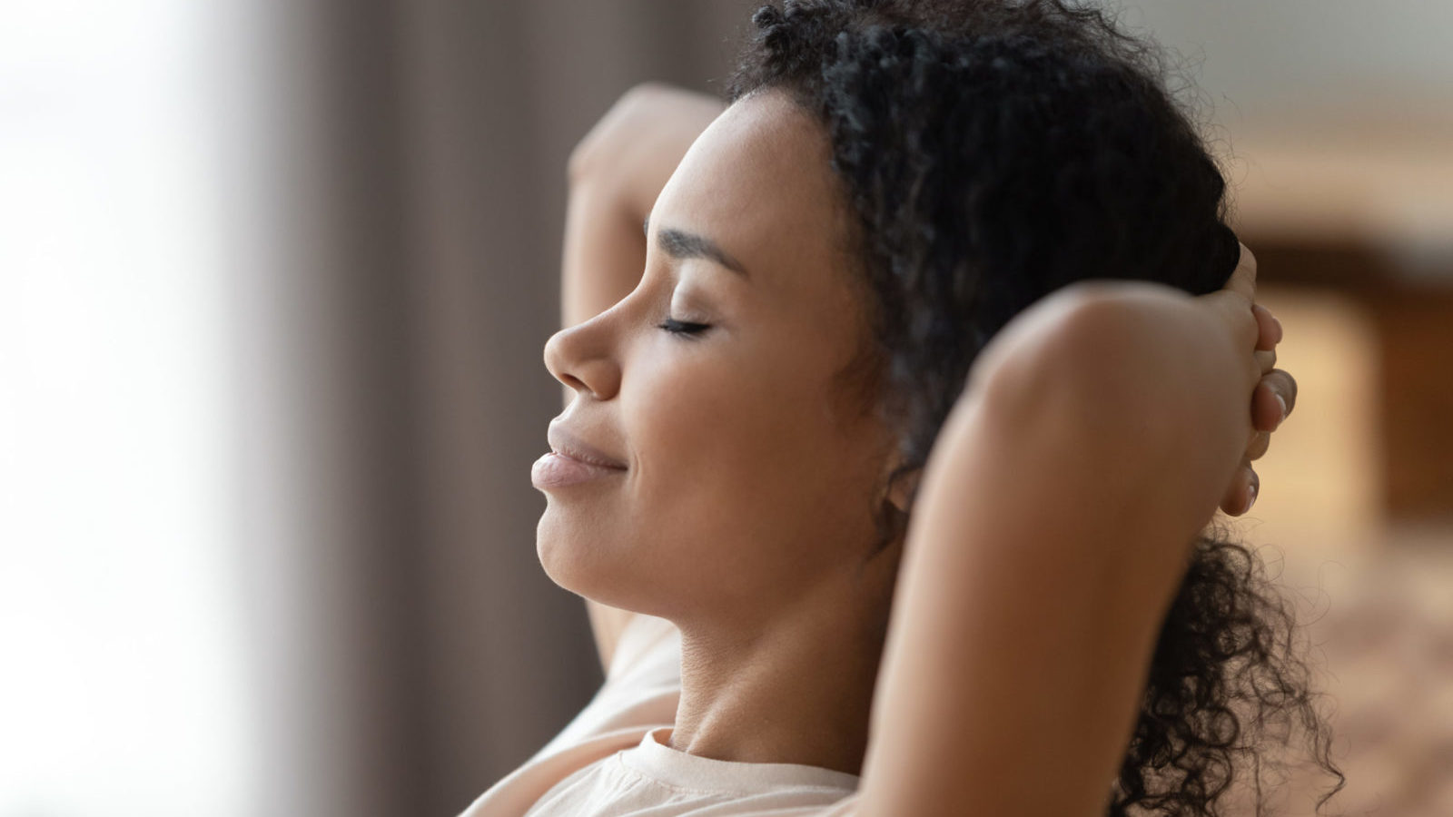 Close up of calm woman relax practicing mindfulness